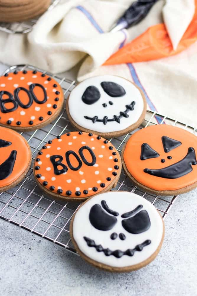 Halloween Cookies are classic soft cut out chocolate sugar cookies made with cocoa powder and decorated with easy sugar icing!