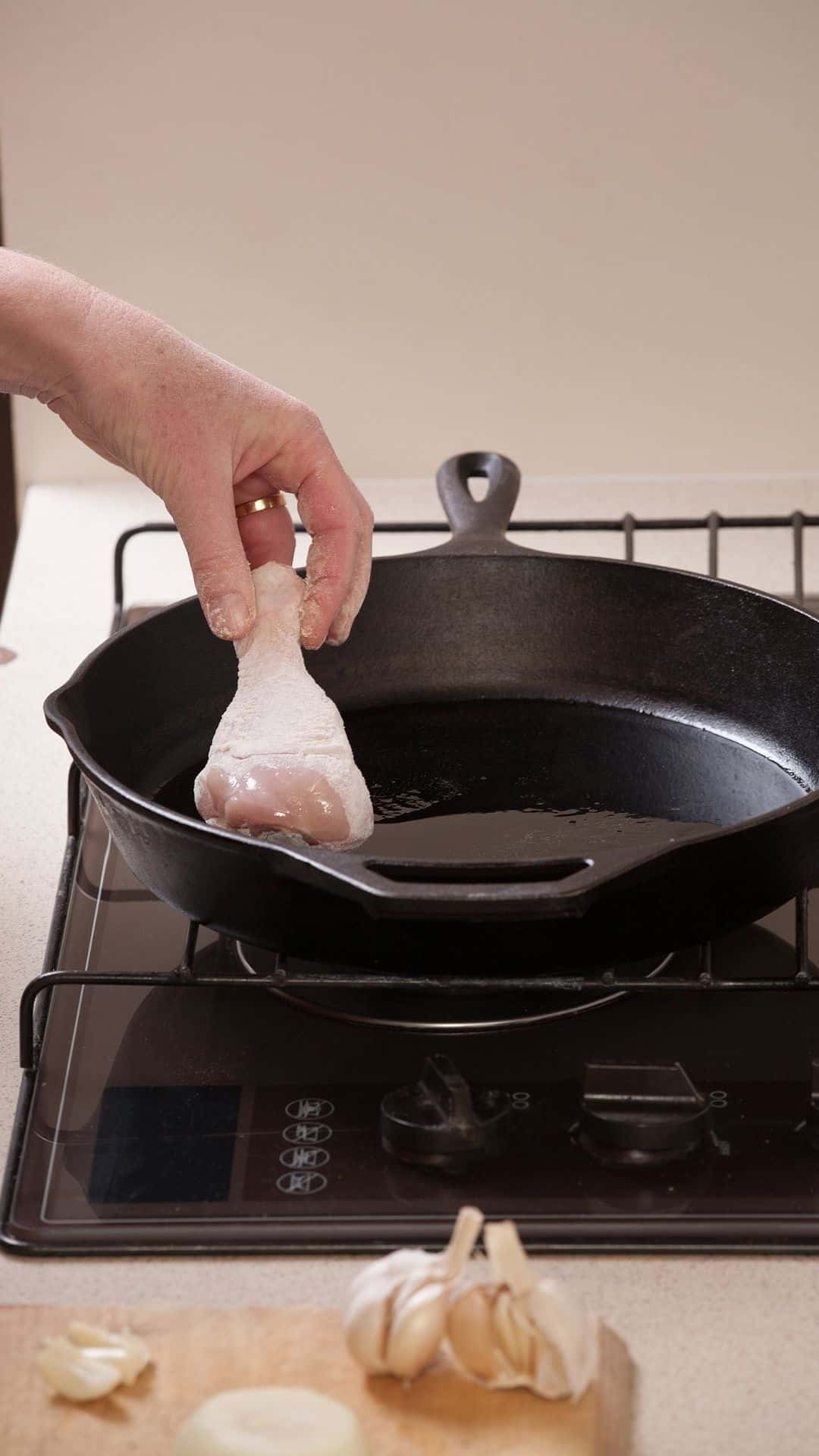dropping breaded chicken into hot oil