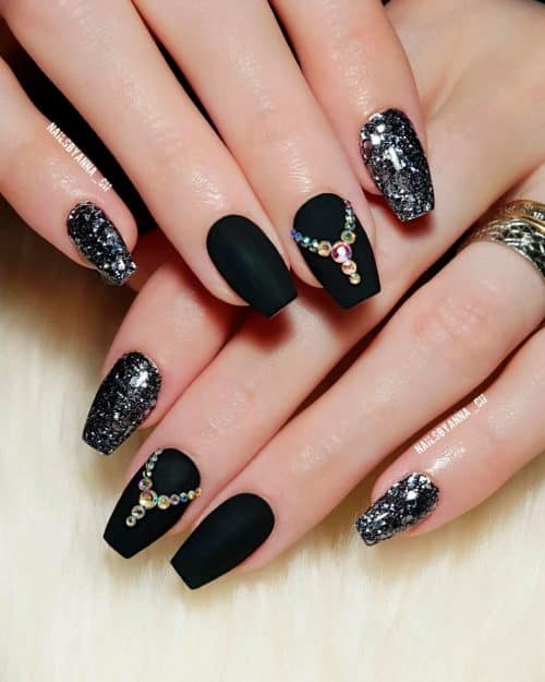 Amazing matte black coffin nails with rhinestones and two silver glitter nails