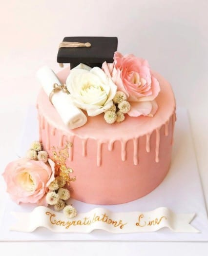 Elegant Pink Cake with Cap and Flowers