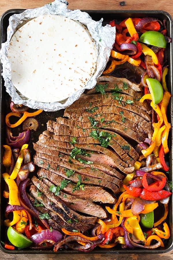 sheet pan steak fajitas with flour tortillas
